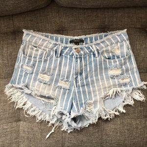 Destroyed denim festival shorts Size M